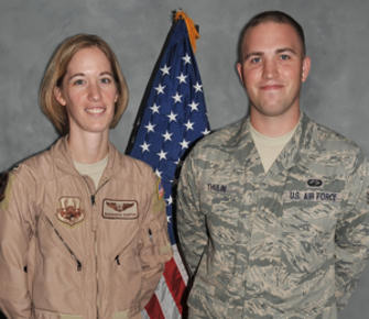 Senior Airman Timothy Thulin (right), 380th Expeditionary Contracting Squadron is 1st Lt. Barbara Sartin's (left), 963rd Expeditionary Airborne Air Control Squadron, little brother. Both Airmen are deployed to the same undisclosed locaton in Southwest Asia, June 9, 2010. Photo by Master Sgt. Scott Sturkol