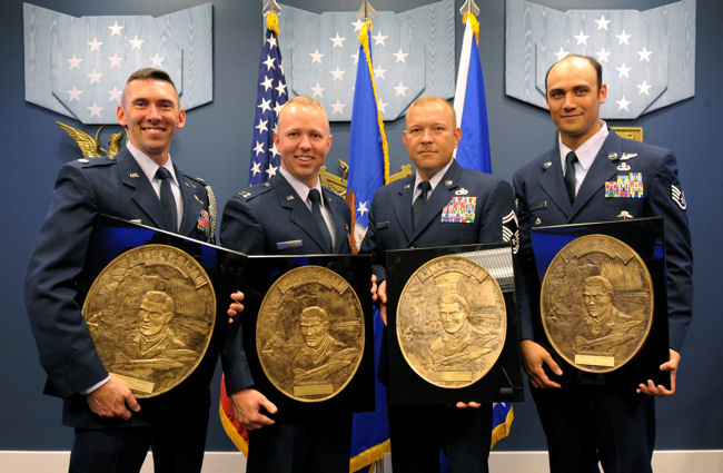 Lt. Col. Roger A. Sherman (from left), Capt. Thomas Phillips (accepting on behalf of his sister, Capt. Rachel Phillips), Senior Master Sgt. Jesse D. Schraner and Staff Sgt. Gino P. Kahaunaele pose with their respective 2009 Lance P. Sijan Leadership Awards following a ceremony April 21, 2010, in the Pentagon's Hall of Heroes. The annual award was created in 1981 to recognize four Airmen who demonstrate the highest qualities of leadership both in and out of uniform.