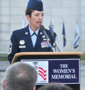 Chief Master Sgt. Denise Jelinski-Hall celebrates the history of the American fighting woman during her Veterans Day speech Nov. 11, 2010, at the Women in Military Service for America Memorial at Arlington National Cemetery in Arlington, Va. Chief Jelinski-Hall is the National Guard senior enlisted advisor. U.S. Air Force photo/Tech. Sgt. Leisa Grant