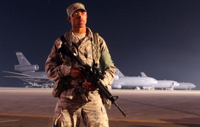 Air Force Staff Sgt. LeTari Myles watches over the flightline in the early morning hours at a base in Southwest Asia, Jan. 18, 2010.