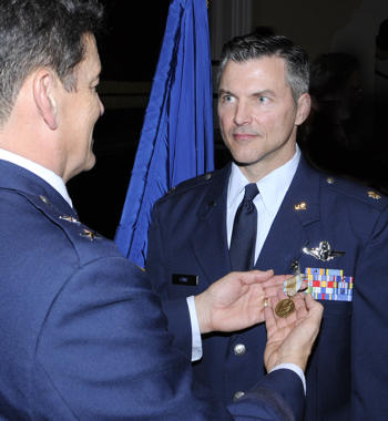 Maj. Gen. Frank Padilla presents the Airman's Medal to Lt. Col Richard L. Lowe at a ceremony Dec. 10, 2010, at Randolph Air Force Base, Texas. Colonel Lowe distinguished himself by heroism involving voluntary risk of life following the crash of Continental Airlines Flight 1404 Dec. 20, 2008, at Denver International Airport. General Padilla is the 10th Air Force commander at Air Force Reserve Command Joint Reserve Base at Fort Worth, Texas. Colonel Lowe is a 340th Reserve Flight instructor. (U.S. Air Force photo/Don Lindsey