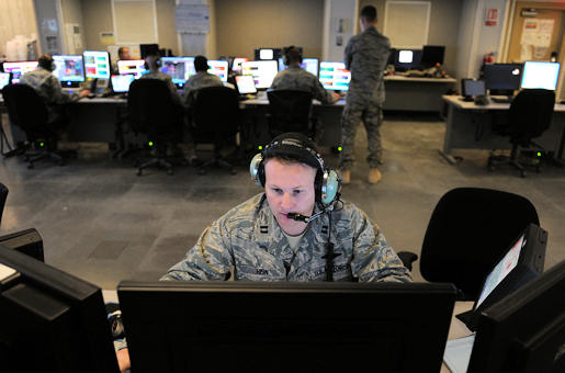 Capt. Owen Hein directs both support and combat aircraft into target areas July 13, 2009, in Southwest Asia. The 71st Expeditionary Air Control Squadron provides around-the-clock air defense and air battlespace management of the area of responsibility. Captain Hein is a 71st EACS air weapons officer. U.S. Air Force Photo by Staff Sgt. Robert Barney