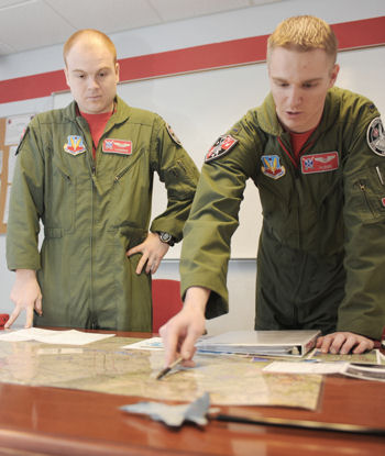 1st Lt. Clayton Couch gives a low-level brief to Capt. Tom Bean for their flight Feb. 5, 2010, at Seymour Johnson AFB, N.C. Lieutenant Couch is weapons systems officer student and Captain Bean is a student pilot attending the 333rd Fighter Squadron Basic Course.