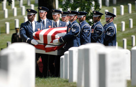 An Air Force honor guard carries a casket holding unidentified remains during a burial service at Arlington National Cemetery, June 17, 2010. The ceremony honored 14 airmen who were killed in March 1972 when their aircraft was shot down over southern Laos.