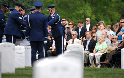 Families observe as an Air Force honor guard folds the flag that draped a casket containing unidentified remains during a burial service at Arlington National Cemetery, June 17, 2010. The ceremony honored 14 airmen who were killed in March 1972 when their aircraft was shot down over southern Laos.