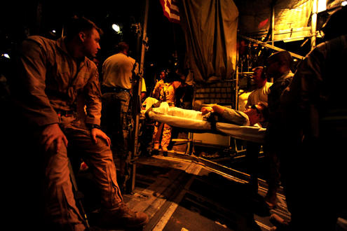 Reservists assigned to the 362nd Expeditionary Aeromedical Evacuation Flight carry on a litter patient for transport aboard a C-130 Hercules aircraft during an aeromedical mission July 17, 2010, at Tikrit, Iraq. U.S. Air Force photo/Staff Sgt. Andy M. Kin