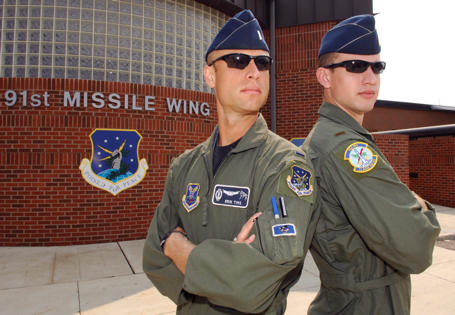 1st Lt. Erik Tims and 2nd Lt. Patrick Tims pose for a photo outside of the 91st Missile Wing headquarters building Aug. 18. The two lieutenants, who happen to be brothers, took part in a once-in-a-lifetime event at Minot AFB here by pulling their first and last alert together Aug. 19, 2010 at Minot AFB. N.D. Erik and Patrick are both with the 742nd Missile Squadron here.