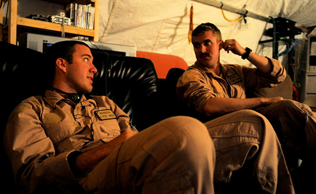 Senior Airman J.C. Wardean, an HC-130P Hercules loadmaster and First Lieutenant John Graham, HC-130P pilot, both assigned to the 79th Expeditionary Rescue Squadron, enjoy a video game and talk, April 18, 2010, at Camp Bastion, Afghanistan.