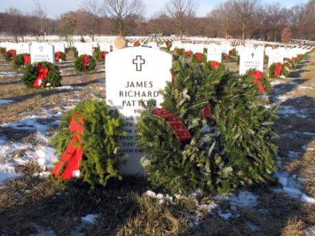 Christmas wreaths adorn the grave of Army Staff Sgt. James R. Patton at Arlington National Cemetery, Dec. 21, 2010. Patton was serving his seventh overseas deployment since 9/11 with the 3rd Battalion, 75th Ranger Regiment, when he died in a helicopter crash in Tikrit, Iraq, on April 18, 2010.