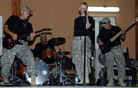 "Members of the 101st Airborne Division rock band ""Nuts,"" perform a concert for personal stationed at International Security Assistance Force headquaters, July 11, 2010. ISAF photo by U.S. Army Spc. Lester B. Colley"