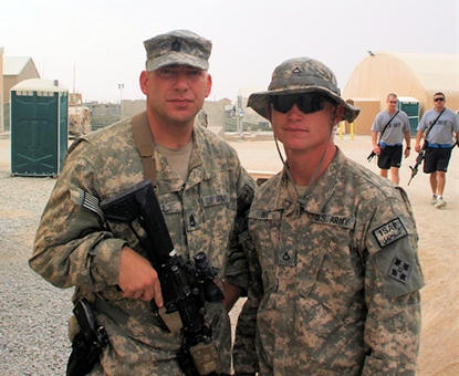 Army Sgt. 1st Class Marc Seal, left, stands with his son, Army Pfc. Nolan Seal, at Kandahar Airfield, Afghanistan, Aug. 9, 2010. Courtesy photo