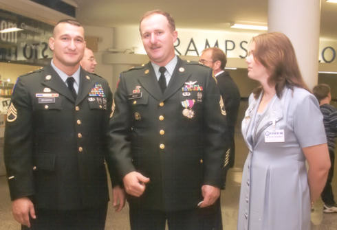 Sgt. 1st Class Walter Wood, middle, stands with Elaine Wood and Staff Sgt. Christopher Braman, during Wood's retirement Dec. 7, 2001. Braman was at the Pentagon during the 9/11 attacks and worked all night searching through the ashes of the burning building in the aftermath. Courtesy photo
