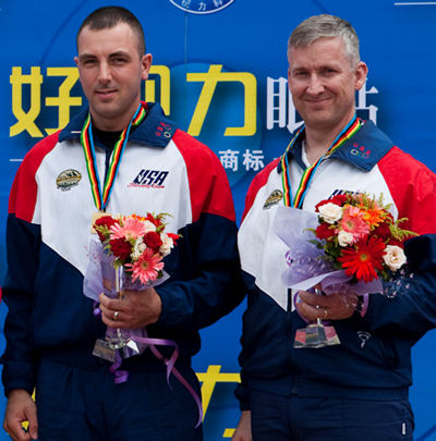 Spc. Joe Hein (middle), U.S. Army Marksmanship Unit, won a gold medal in the Men's 50m Rifle Prone match at the 2010 China World Cup. Sgt. 1st Class Eric Uptagrafft (right), Hein's fellow USAMU teammate, won a bronze medal in the same match.