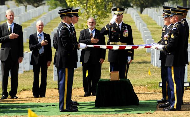 Honor guard Soldiers from the 3rd U.S. Infantry Regiment (The Old Guard) pay honors to 1st Lt. Vernon J. Baker during his burial at Arlington National Cemetery September 24, 2010.
