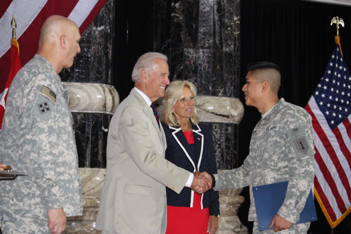 Vice President Joe Biden congratulates a soldier on becoming a U.S. citizen during a naturalization ceremony in Al Faw Palace on Camp Victory, Iraq, July 4, 2010. Biden's wife, Dr. Jill Biden, and Army Gen. Raymond T. Odierno, commander of U.S. Forces Iraq, also attended the event, during which more than 150 U.S. servicemembers became U.S. citizens. DoD photo by Elaine Wilson