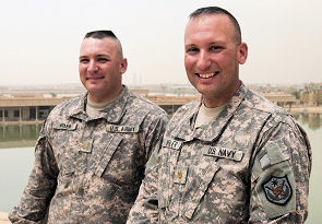 Army Maj. Shawn Butler, left, and his older brother, Navy Lt. Cmdr. Richard Butler, are both assigned III Corps, despite belonging to different branches of the service. On June 28, Lt. Cmdr. Butler will complete a blue-to-green transfer to become an Army major.