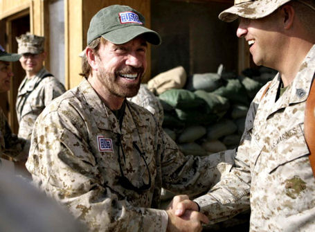 Chuck Norris, an honorary Marine, visits Marines in Iraq in 2008.