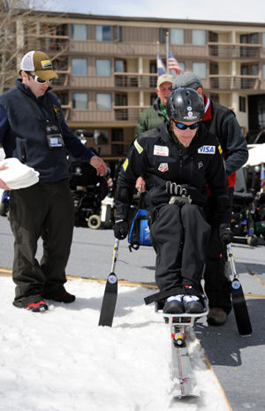 Sean Halsted gets strapped into a mono-ski outside The Silvertree Hotel for the 24th National Disabled American Veterans Winter Sports Clinic March 30, 2010, in Snowmass Village, Colo. Mr. Halsted is an Air Force veteran and resides in Rathdrum, Idaho. The event is sponsored by the Department of Veterans Affairs and Disabled American Veterans.