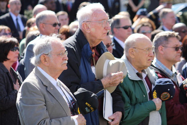 William Stecher, Ernest Dyson and Doug Fargo attend a ceremony in honor of fallen military medical personnel at Arlington National Cemetery in Arlington, Va., March 16, 2010. Stecher and Fargo's grandson, Army Cpl. Adam J. Fargo, a medic, was killed in Iraq in July 2006.