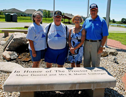 Mr. and Mrs. Lloyd Proctor stand next to Maj. Gen. and Mrs. R. Martin Umbarger at the Proctor Park memorial in Whiteland, Ind., June 19. Umbarger and his wife donated the engraved bench in honor of Mr. and Mrs. Proctor's late son, Sgt. Joseph Proctor, a New Whiteland native who made the ultimate sacrifice, May 3, 2006 in Ramadi, Iraq.
