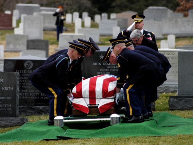March 2, 2010 -- Soldiers of the 3rd U.S. Infantry lower the casket of Gen. Alexander Haig into its final resting place in section 30 of Arlington National Cemetery. Photo by Alex McVeigh, Pentagram Staff Writer