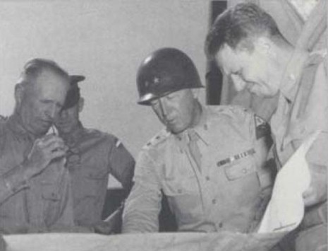 Maj. Gen. George S. Patton Jr. (center) studies a map during World War II with General Lesley J. McNair (left), chief of staff of General Headquarters and later commanding general of U.S. Army Ground Forces. U.S. Army photo