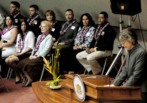 Hawaii Governor Linda Lingle offers words of encouragement to family members, friends and co-workers of 28 fallen servicemembers who were posthumously presented the Hawaii Medal of Honor during her remarks at a special ceremony March 23, 2010, at the State Capitol in Honolulu, Hawaii.