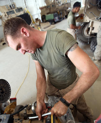 Lance Cpl. Andrew C. Adams, 26, from Fort Worth, Texas, motor transport mechanic with Maintenance Company, Combat Logistics Regiment 15 (Forward), 1st Marine Logistics Group (Forward), repairs a Mine-Resistant Ambush Protected vehicle at the Intermediate Maintenance Activities lot at Camp Leatherneck, Afghanistan, May 21. MRAPs can cost up to $1 million, and the mechanics are able to fix a vehicle damaged by an IED within a few weeks, depending on damage sustained, saving time and money for the Marine Corps.