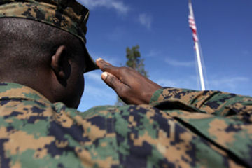 Sgt. Togai Y. Andrews, administrative law noncommissioned officer in charge, Marine Corps Installations West, Camp Pendleton, renders honors to the American flag with a salute, at bldg. 1160, Feb. 10. As the United States celebrates February as Black History Month, the Marine Corps recognize the many African-Americans who served as Marines.