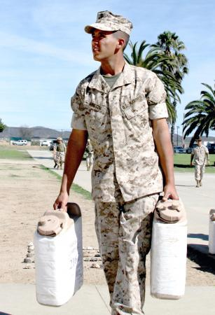 Pvt. Eric Austin unloads his platoon's five-gallon water jugs after completing the Crucible at Weapons and Field Training Battalion, Marine Corps Base Camp Pendleton, Calif., Oct. 28, 2010. The Crucible is a 54-hour training exercise in which recruits get little food and sleep. U.S. Marine Photo by Pfc. Mike Ito