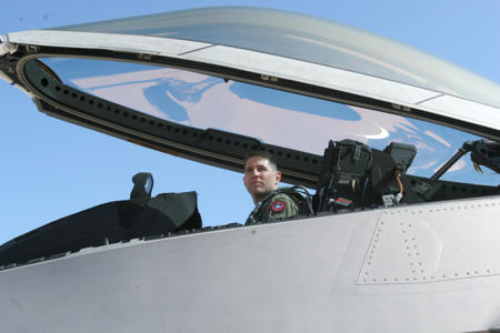 "After climbing into the cockpit of an F-22 ""Raptor"" to perform a system's check, Lt. Col. David R. Berke, the Marine Corps F-22 exchange pilot, 422nd Test and Evaluation Squadron, Nellis Air Force Base, Nev., glances over to his air traffic controller for further instructions June 25, 2010. For approximately four weeks, Berke participated in exercise Trident Warrior held at Marine Corps Air Station Miramar."