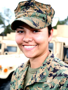 Marine Corps Cpl. Amy Gentry stands in her company's vehicle compound at Camp Lejeune, N.C., March 11, 2010.