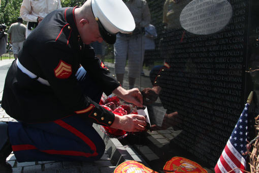 Cpl. John J. Granville, a food service specialist with Marine Corps Mountain Warfare Training Center, Pickel Meadows, Calif., gets a rubbing of his father's name for the first time May 31, 2010, at the Vietnam Veterans Memorial Wall in Washington. His father, John E. Granville, who served with 1st Battalion, 7th Marine Regiment, in the Vietnam War, died in 2007 from a heart condition that stemmed from injuries he sustained in Vietnam. His name was added to the wall earlier this month.