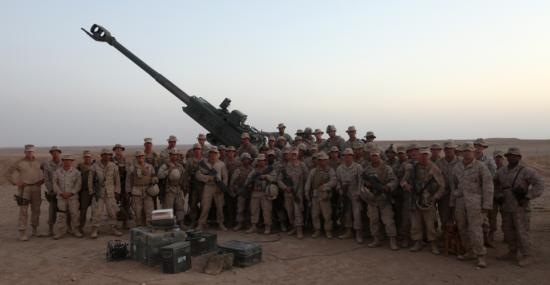 Marines with Bravo Battery, 1st Battalion, 11th Marine Regiment, 1st Marine Division (Forward), stand in front of an M777 Lightweight Howitzer cannon, Sept. 28, 2010. The Marines support nearby units with artillery fire from their firebase named in honor of their fallen comrade, Sgt. Jose Saenz III.
