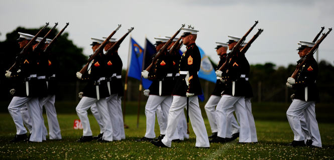 Gunnery Sgt. J.P. Johnson, the platoon sergeant for the United States Marine Silent Drill Platoon, marches his platoon during a performance aboard Camp Hansen in Okinawa, Japan on March 5, 2010.