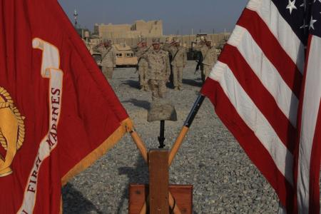 Marines with Headquarters Company, 3rd Battalion, 1st Marine Regiment, salute to honor Cpl. Max W. Donahue during a memorial service at Forward Operating Base Delhi, Helmand province, Afghanistan, Aug. 21, 2010.