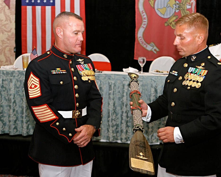 Sergeant Maj. William F. Fitzgerald III, the sergeant major of United States Marine Corps Forces South, is awarded a reconnaissance paddle by Maj. Bradford Carr, commanding officer of Force Reconnaissance Company, II Marine Expeditionary Force on October 29, 2010. Fitzgerald was the guest of honor at the Force Reconnaissance Co. ball. (U.S. Marine Corps photo by Lance Cpl. Daniel A. Wulz)