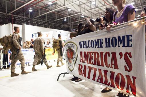 "Friends and family members greet Marines and sailors with 3rd Battalion, 3rd Marine Regiment, at their return to Marine Corps Base Hawaii from a seven-month deployment to Afghanistan, Dec. 7, 2010. The return of ""America's Battalion"" brought 925 Marines back to Hawaii."