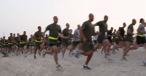 Runners take off at the start of the Maj. Megan McClung memorial race at Camp Leatherneck, Afghanistan, Aug. 14, 2010. This was the first time the race has been held in Afghanistan.