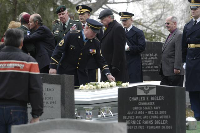 Fellow Soldiers pay their respects to Medal of Honor recipient Col. Robert L. Howard, who was buried Feb 22 in Section 7A of Arlington National Cemetery. Forteen Medal of Honor recipients and other heroes are buried in that section Howard was one of the most highly decorated Soldiers in Vietnam.