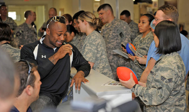 Vernon Davis of the San Francisco 49ers signs autographs for servicemembers March 5, 2010 at the Craig Joint Theater Hospital at Bagram Airfield, Afghanistan.
