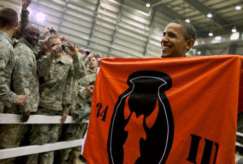 President Barack Obama holds a banner while visiting with U.S. troops at Bagram Air Field in Afghanistan, Dec. 3, 2010. Official White House Photo by Pete Souza