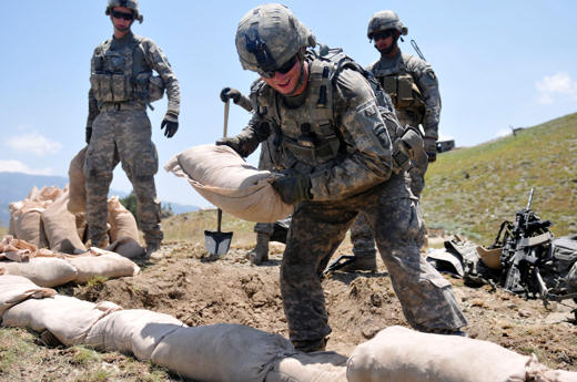 U.S. Army Pfc. David W. Wilson of Salisbury, N.C., a grenadier with 1st Squad, 2nd Platoon, 2nd Battalion, 327th Infantry Regiment, Task Force No Slack, stacks sandbags in an effort to improve a fighting position at Combat Outpost Thomas above the Marawarah District here July 7, 2010. The soldiers continuously work to improve their fighting positions while ever mindful of the extreme weather conditions that surpass 100 degrees daily. Coalition forces pushed insurgents out of the district only days earlier and are setting up permanent outposts to prevent insurgents from returning to the area.