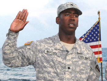 Army Spc. Carlos Baptista of the Rhode Island Army National Guard's 115th Military Police Battalion takes the U.S. oath of allegiance during his naturalization ceremony at Naval Station Guantanamo Bay, Cuba, April 19, 2010.