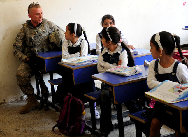 chool girls from Ishtar Primary School help Spc. Chad Cardenas from the 7th Cavalry Regiment with his vocabulary. The 7th and Iraqi Security Forces conducted a book drop in Baghdad April 11, 2010.