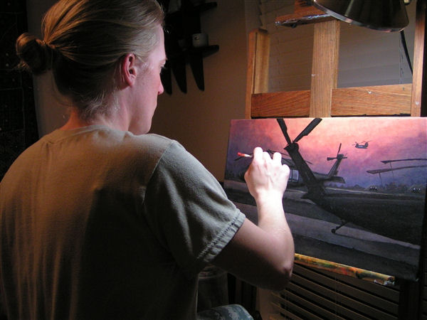 Army 1st Lt. Heather S. Englehart of the Louisiana National Guard paints a scene from her military experiences at her home in New Orleans, March 31, 2010.