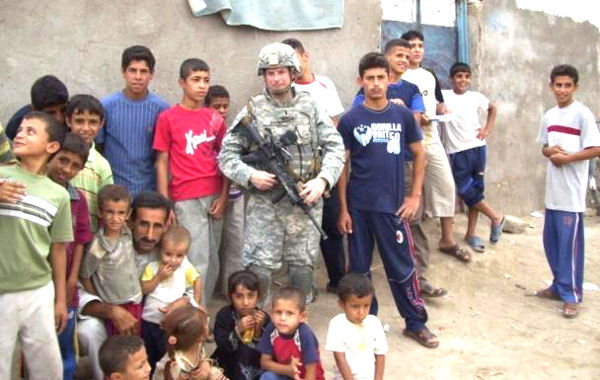 January 20. 2010 - Army 1st Lt. Nicholas Griffo visits with children during a patrol in Iraq's Basra province.