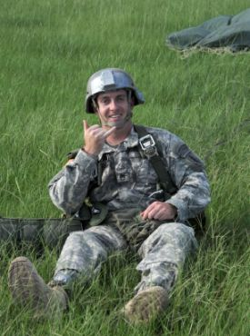 Army Staff Sgt. Andre Murnane of the Maryland National Guard is all smiles in Grenada, Miss., after being the first National Guard Special Forces soldier to jump with a prosthetic, Aug. 1, 2010.