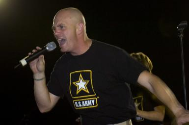 "Staff Sgt. Randy B. Wight from Syracuse, N.Y. with the U.S. Army Field Band ""The Volunteers"" from Fort Meade, MD sings for troops at Camp Victory, Iraq on September 19, 2010. Photo by Army Staff Sgt. Daniel Yarnall"