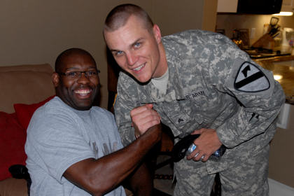 "Sgt. Christopher Stevens, from Orlando, Fl., assigned to D Company, 1st Battalion, 12th Cavalry Regiment, 3rd Brigade Combat Team, 1st Cavalry Division, shares a ""Man Hug"" after visiting with Sgt. 1st Class Charles Armstead, a former platoon sergeant with D Co., 1st Bn., 12th Cav, Regt., during a brigade visit to Brooke Army Medical Center in San Antonio, July 13, 2010 to encourage its wounded warriors to coutiune their mission of recovery and rehabilitation."